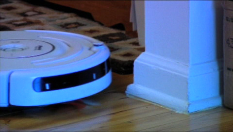 Roomba runs into a wall.