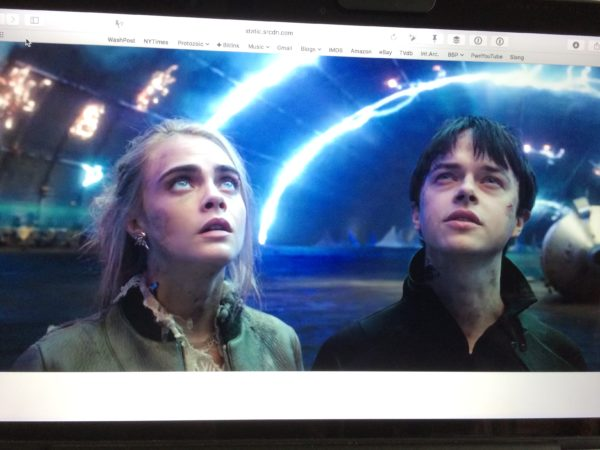 Cara Delevingne's Sergeant Laureline and Dane DeHaan's Major Valerian stare at the top of a web browser.